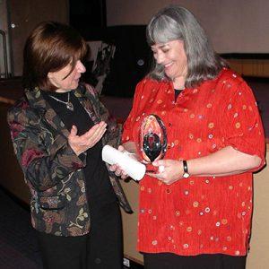 Beth Robertson receiving her award